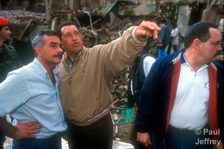 Jesuit Father Jose Virtuoso, left, with Venezuelan President Hugo Chavez during a visit by the Venezuelan leader to the Caracas neighborhood of Catuche in January 2000, shortly after flooding and mudslides destroyed hundreds of homes in the neighborhood.