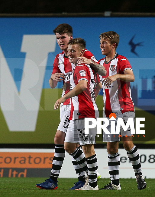 Matt Jay of Exeter City congratulates goalscorer Liam McAlinden (left) of Exeter City during the The Checkatrade Trophy match between Oxford United and Exeter City at the Kassam Stadium, Oxford, England on 30 August 2016. Photo by Andy Rowland / PRiME Media Images.