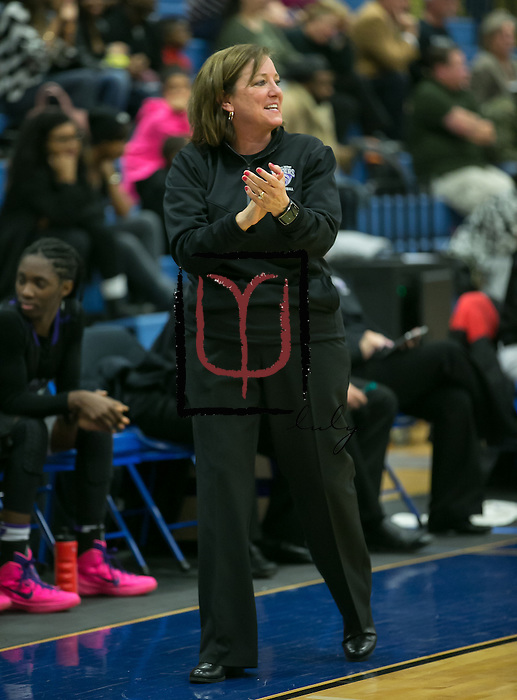 Cedar Ridge head coach Angela Beck applauds her team's performance Friday against Pflugerville.  The Raiders rolled the Panthers 64-39.  (LOURDES M SHOAF for Round Rock Leader.)