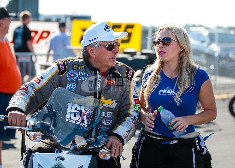 Sep 3, 2018; Clermont, IN, USA; NHRA funny car driver John Force (left) with daughter Brittany Force during the US Nationals at Lucas Oil Raceway. Mandatory Credit: Mark J. Rebilas-USA TODAY Sports