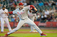 Philadelphia Phillies pitcher Roy Halladay #34 delivers a pitch during the Major League Baseball game against the Houston Astros at Minute Maid Park in Houston, Texas on September 14, 2011. Philadelphia defeated Houston 1-0 to clinch a playoff berth.  (Andrew Woolley/Four Seam Images)