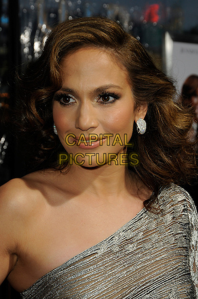 "JENNIFER LOPEZ .arriving at the premiere of CBS Films' ""The Back-up Plan"" at the Regency Village Theatre in Westwood, California, USA, April 21st, 2010..arrivals portrait headshot one shoulder silver earrings wavy hair .CAP/ROT.©Lee Roth/Capital Pictures"