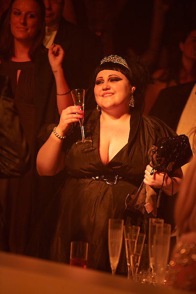 Beth Ditto watches Elton John and George Michael perform during The White Tie and Tiara Ball