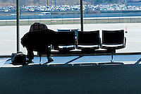 Man waiting for a flight at Cleveland Hopkins International Airport.