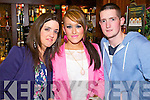 COUNTDOWN: Sarah Sheehan and Sheridan Dwyer (Castlemaine) with Cathal McCarthy (Lixnaw) pictured in Charlie Foley's Bar, Killarney, for the New Year's Eve countdown.