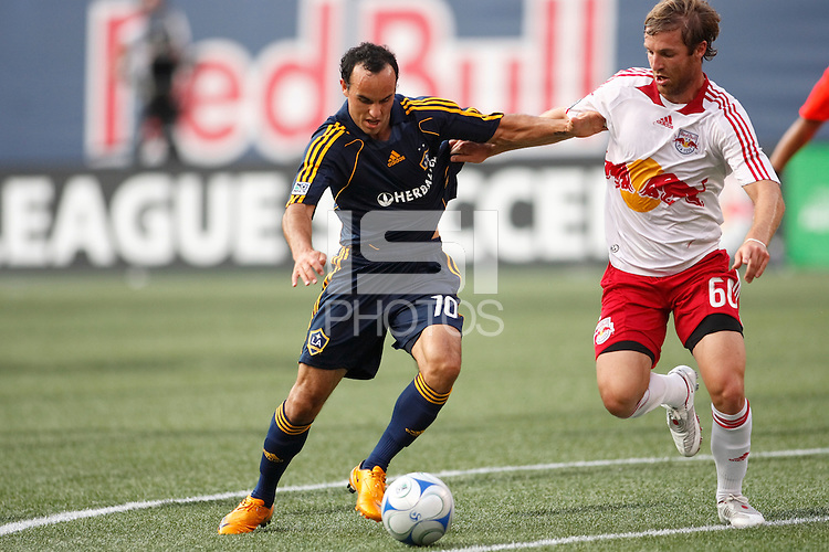 Los Angeles Galaxy midfielder Landon Donovan (10) is marked by New York Red Bulls defender Jeff Parke (60). The New York Red Bulls and the Los Angeles Galaxy played to a 2-2 tie during a Major League Soccer match at Giants Stadium in East Rutherford, NJ, on July 19, 2008.
