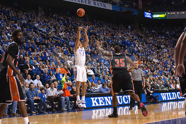 Guard Devin Booker of the Kentucky Wildcats shoots a three during the second half of the game against the University of Georgetown Tigers at Rupp Arena on Sunday, November 9, 2014 in Lexington, Ky. Kentucky defeated Georgetown 121-52. Photo by Michael Reaves | Staff