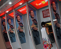People withdraw money from an ATM of Bank of Dongguan in Guangzhou, China. The financial crisis won't have too much impact on Chinese consuming market. According to a survey by Nielsen of 50 countries and regions, only 35 percent of Chinese people believed the domestic economy was in a contraction. The figure was the lowest among the 50 world markets..