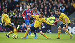 Crystal Palace's Jordan Ayew is challenged by Arsenal's Alexandre Lacazette (L), Lucas Torreira (C) and Sokratis Papastathopoulos during the Premier League match at Selhurst Park, London. Picture date: 11th January 2020. Picture credit should read: Paul Terry/Sportimage