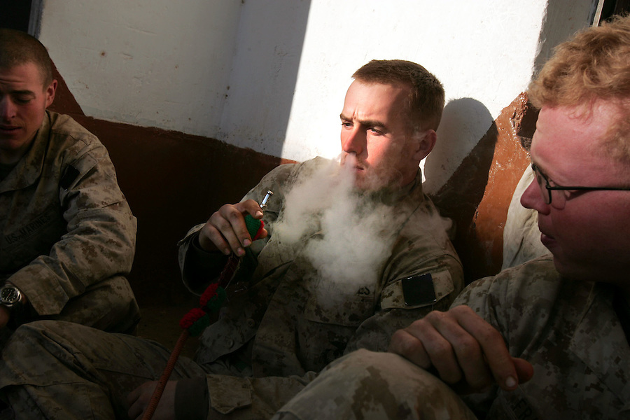 Marines from Lima Co. 3rd Battalion 6th Marines shaking off an achy cold morning smoke a water-pipe in the early hours of the sixth day of Operation Steel Curtain, an operation to clear Husaybah and Karabilah (two cities on the Iraq-Syrian border) of insurgents on Fri. Nov. 11, 2005.