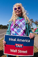 "Marion, in her awesome round purple sunglasses, holds a ""Heal America, tax Wall Street"" sign at the Occupy Orange County, Irvine camp on November 5."