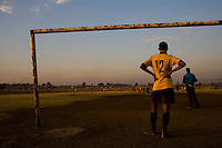 JOHANNESBURG, SOUTH AFRICA - JULY 19:  A football/soccer team warm up before a match in Soweto, South Africa.  (Photo by Landon Nordeman)