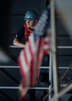 110120-N-7981E-522 PACIFIC OCEAN (Jan. 20, 2011)- Boatswain's Mate Seaman Daniel Dulin waits to participate in the launch of a Rigid Hull Inflatable Boat (RHIB) aboard the aircraft carrier USS Carl Vinson (CVN 70). Carl Vinson and Carrier Air Wing 17 are underway on a deployment to the U.S. 7th Fleet area of responsibility. (U.S. Navy photo by Mass Communication Specialist 2nd Class James R. Evans / RELEASED)