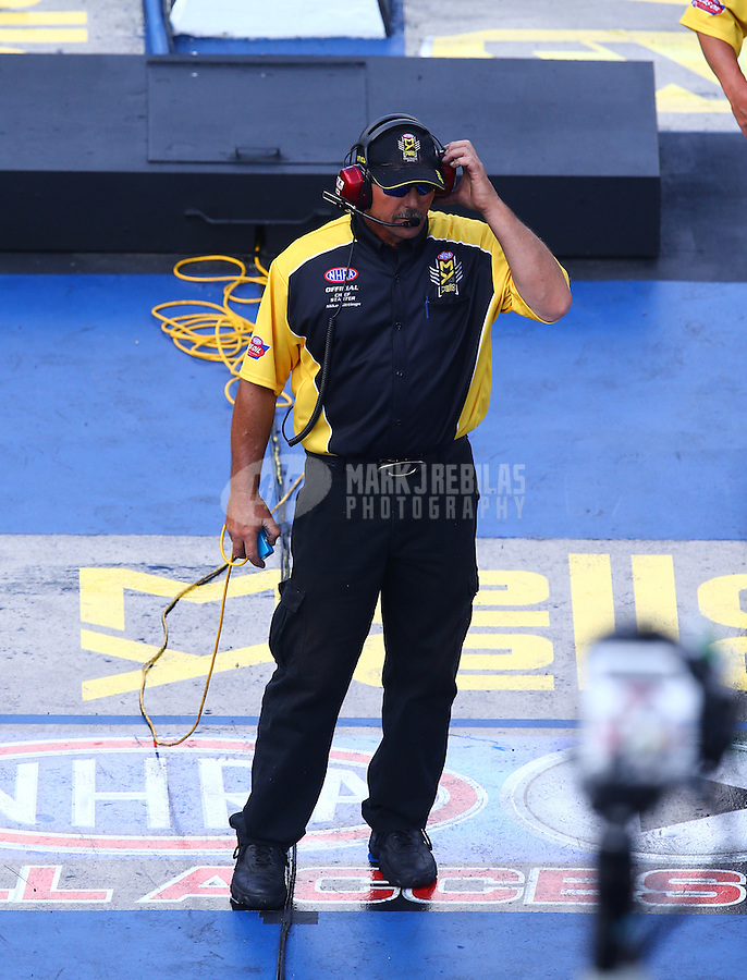Jun 17, 2016; Bristol, TN, USA; NHRA official starter Mike Gittings during qualifying for the Thunder Valley Nationals at Bristol Dragway. Mandatory Credit: Mark J. Rebilas-USA TODAY Sports