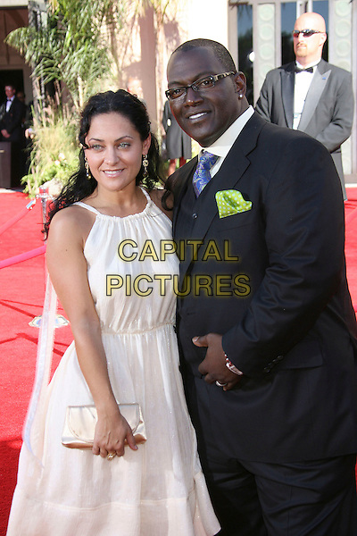 RANDY JACKSON & GUEST.Red Carpet Arrivals - 58th Annual Primetime Emmy Awards held at the Shrine Auditorium,  Los Angeles, California, USA, 27 August 2006..emmys half length.Ref: ADM/ZL.www.capitalpictures.com.sales@capitalpictures.com.©Zach Lipp/AdMedia/Capital Pictures.