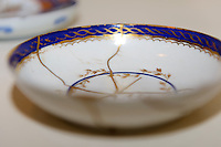 "A saucer repaired with kintsugi. Kintsugi event, Daiwa Anglo-Japanese Foundation, London, UK, January 24, 2014. Kintsugi literally means ""joining with gold"": a technique to piece together broken pottery or glass with lacquer, rice-glue and gold."