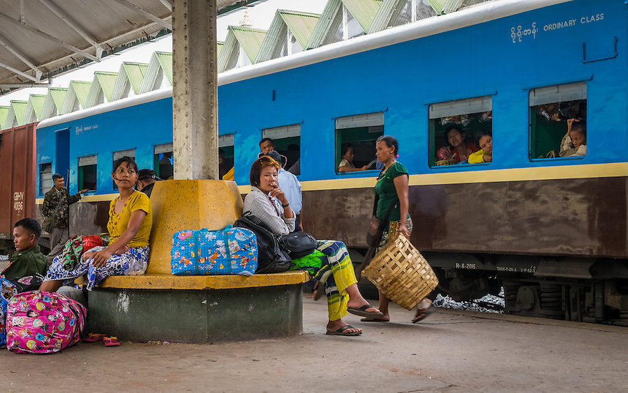 YANGON, MYANMAR - CIRCA DECEMBER 2013: Passengers waits on the train platform at the Yangon Central Railway Station