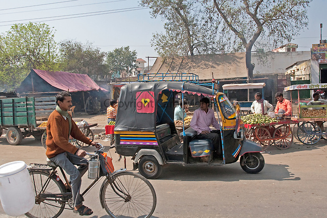 Delhi (state), India. Typical traffic in India includes bicycles and tuk tuks (similar to a very small taxi)