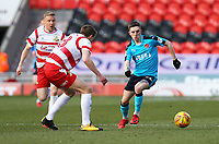 Ashley Hunter of Fleetwood Town taking on George Glendon of Fleetwood Town during the Sky Bet League 1 match between Doncaster Rovers and Fleetwood Town at the Keepmoat Stadium, Doncaster, England on 17 February 2018. Photo by Leila Coker / PRiME Media Images.