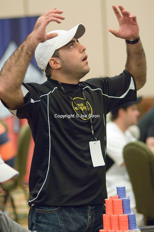 Marc Karam reacts as he contemplates making a call.  He does and wins big pot.