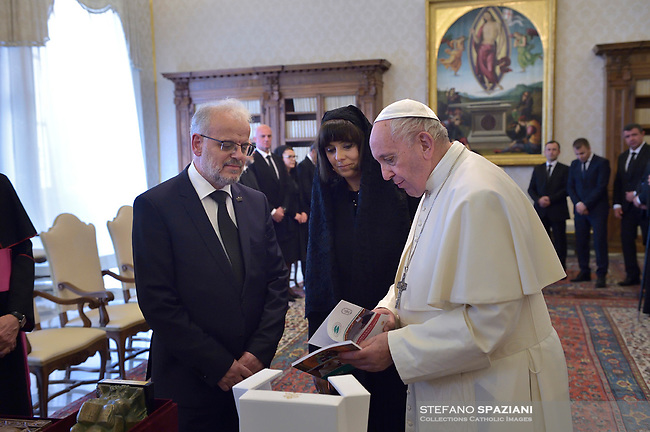 Pope Francis walks with Talat Xhaferi, president of North Macedonia's parliament, second left, on the occasion of their private audience at the Vatican, Friday, May 24, 2019.