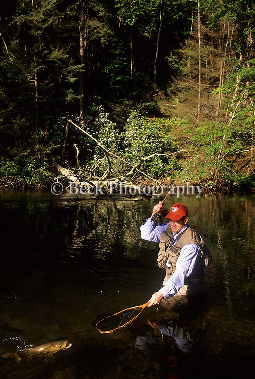 Jim Wood landing a brown trout in PA