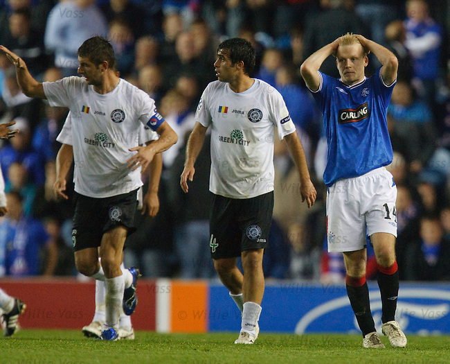Steven Naismith distraught after the ball cannons off him and into the net for a Unirea goal