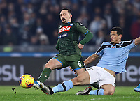 11th January 2020; Stadio Olympico, Rome, Italy; Serie A Football, Lazio versus Napoli; Mario Rui of Napoli is slide tackled by Luis Felipe of Lazio - Editorial Use