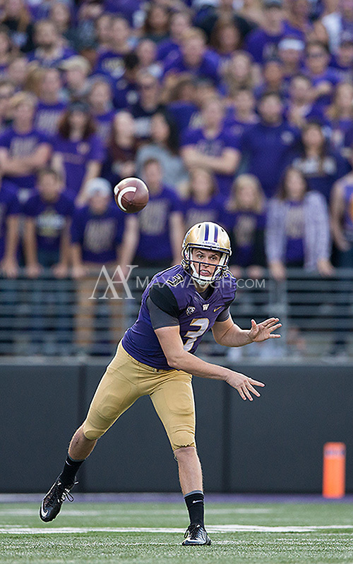 Jake Browning fires a pass toward Chico McClatcher.