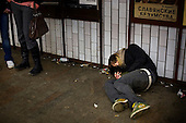 A drunk Russian youth lays in a subway in Moscow several days after the New Year celebrations. .Alcoholism is one of the main causes of death in Russia.