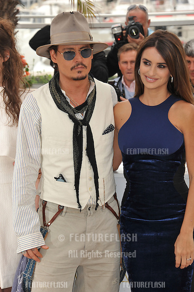 """Johnny Depp & Penelope Cruz at the photocall for their movie """"Pirates of the Caribbean: On Stranger Tides"""" at the 64th Festival de Cannes..May 14, 2011  Cannes, France.Picture: Paul Smith / Featureflash"""