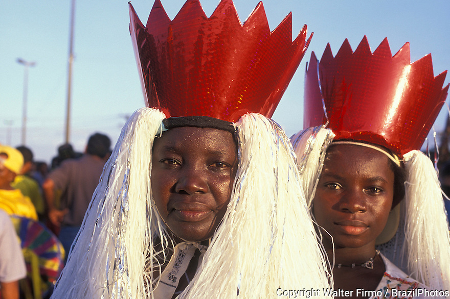 Black women wearing traditional costumes. Mother and daughter. Bumba-meu-boi, popular party that mix religious elements and ancient fables. Afro-descendant people. City: São Luís; State: Maranhão; Brazil.