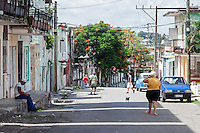 A small dog and a large woman, Diez de Octubre, Habana
