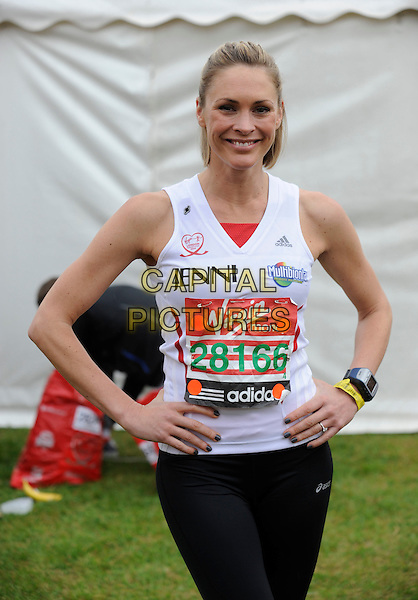 JENNI FALCONER .Celebrities take part in the Virgin London Marathon 2010, London, England, UK, 25th April 2010..half  length white vest top black leggings hands on hips smiling wrist watch engagement ring .CAP/DH.©David Hitchens/Capital Pictures.