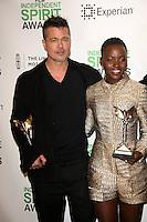 Brad Pitt, Lupita Nyong'o<br /> at the 2014 Film Independent Spirit Awards Press Room, Santa Monica Beach, Santa Monica, CA 03-01-14<br /> David Edwards/Dailyceleb.com 818-249-4998