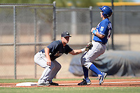 Seattle Mariners third baseman Joe DeCarlo (2) tags out base runner Frank Schwindel (12) during an instructional league game against the Kansas City Royals on October 2, 2013 at Surprise Stadium Training Complex in Surprise, Arizona.  (Mike Janes/Four Seam Images)