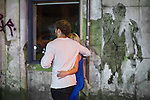 © Joel Goodman - 07973 332324 . 11/09/2016 . Manchester , UK . A couple walk arm in arm past pasted street art of a couple walking arm in arm on Dantzic Street . Revellers out in Manchester City Centre . Photo credit : Joel Goodman