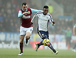 Stephane Sessegnon of West Bromwich Albion tussles with Dean Marney of Burnley - Barclays Premier League - Burnley vs West Bromwich Albion - Turf Moor Stadium  - Burnley - England - 8th February 2015 - Picture Simon Bellis/Sportimage
