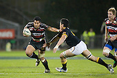 Niva Ta'auso tries to fend off Alex Tulou. Air New Zealand Cup rugby game between Counties Manukau Steelers & Wellington played at Mt Smart Stadium on the 31st August 2007. The Score was 13 all at halftime, with Wellington going on to win 33 - 18.