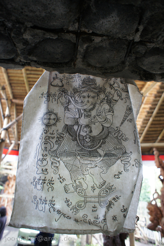 god Ganesha on cotton fixed above entrance of shop and atelier of woodcarver  I Made Ada, Pakudui village Bali, archipelago Indonesia, 2010