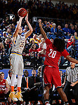 BROOKINGS, SD - DECEMBER 31:  A.J. Hess #35 from South Dakota State University spots up for a jumper over Brandon Armstrong #20 from the University of South Dakota during their game Saturday afternoon at Frost Arena in Brookings. (Dave Eggen/Inertia)