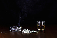 "The ""Last Dollar"" portrays the end a long night at a bar with a glass of whiskey and a cigarette to end the night. Taken at my studio in Belton, Missouri on November 4, 2007"