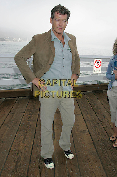 PIERCE BROSNAN.A Day at the Beach and Paddle Out Protest against the proposed Liquid Natural Gas Facility Construction held at Malibu Surfrider Beach, Malibu, California, USA,.22 October 2006..full length black converse trainers beige brown jacket trousers blue shirt hands on hips.Ref: ADM/RE.www.capitalpictures.com.sales@capitalpictures.com.©Russ Elliot/AdMedia/Capital Pictures.