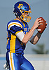 Matthew Sluka #10, Kellenberg quarterback, takes a snap during a CHSAA varsity football game against Holy Trinity at Mitchel Athletic Complex in Uniondale on Sunday, Sept. 17, 2017. Kellenberg won by a score of 45-0.
