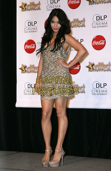 VANESSA HUDGENS .SHOWEST Final Night Talent Awards at the Paris Resort Hotel and Casino,  Las Vegas, Nevada , USA,.18th March 2010..full length gold beaded jewel encrusted embellished dress hand on hip brown peep toe platform shoes ankle strap .CAP/ADM/MJT.© MJT/AdMedia/Capital Pictures.