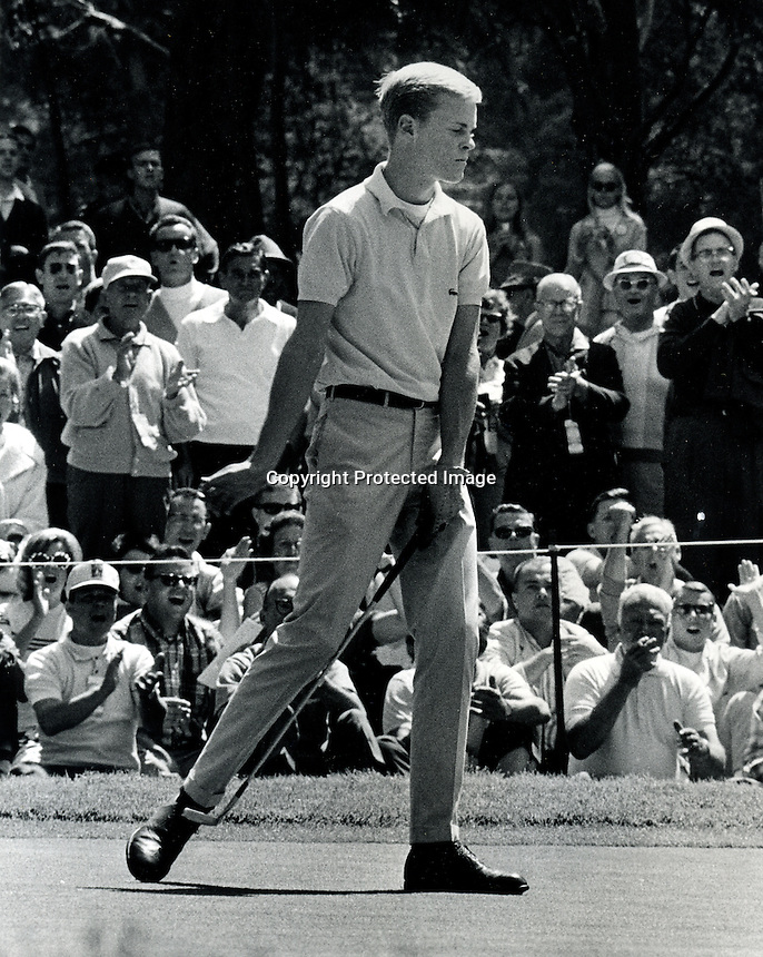 Young Johnny Miller sinks a putt during the 1966 U.S. Open at the Olympic Club in S.F. (copyright 1966 Ron Riesterer)