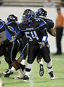 First Coast Buccaneers lineman Samuel Merrell #54 blocks during the fourth quarter of the Florida High School Athletic Association 7A Championship Game at Florida's Citrus Bowl on December 16, 2011 in Orlando, Florida.  Manatee defeated First Coast 40-0.  (Photo By Mike Janes Photography)