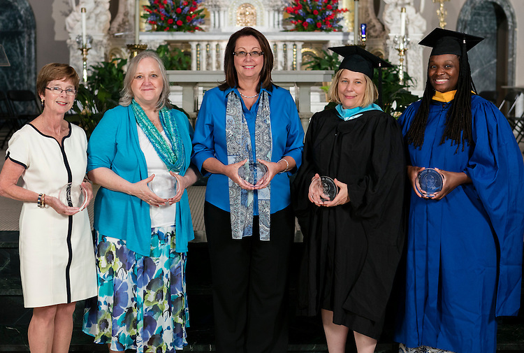 Left to right, Fran Casey, Donna Max, JoAnne Zielinski, Elisabeth Sullivan and Tyneka Harris Coronado, not pictured, Michael Edwards, were presented with Spirit of DePaul Awards during DePaul's annual Academic Convocation at the St. Vincent de Paul Parish Church Thursday, Sept. 1, 2016. The Rev. Dennis H. Holtschneider, C.M., president of DePaul University, presented the awards to faculty and staff. (DePaul University/Jeff Carrion)