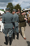 Goodwood Festival of Speed. Goodwood Sussex. UK. Goodwood-Speed goers  wearing Swiss airforce Uniforms cica 1945 and American Army Uniforms.