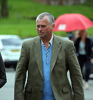 """COPY BY TOM BEDFORD<br />Pictured: Christopher Sabine, the son of John Sabine from a previous marriage, outside the Aberdare Coroner's Court after the verdict Thursday 19 May 2016<br />Re: A man found wrapped in plastic in his Rhondda Cynon Taff garden was unlawfully killed, a coroner has concluded.<br />The body of John Henry Sabine was found at the rear of flats at Trem-y-Cwm, Beddau, on 24 November. The cause of death was blunt force head trauma.<br />Mr Sabine's wife Leigh Ann, who died last October, is the main suspect.<br />His inquest in Aberdare was told she admitted killing her husband with a stone frog in a phone call to a friend.<br />South Wales Central Coroner Andrew Barkley said it was """"beyond doubt in my mind that foul play was the cause of his death"""".<br />He said the cause was blunt force injury to the head, with the evidence about the stone frog fitting with this.<br />The coroner said there was no recorded history of domestic violence or that Mrs Sabine acted in self defence and he was satisfied her husband was unlawfully killed."""